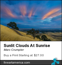 Sunlit Clouds At Sunrise by Marc Crumpler - Photograph